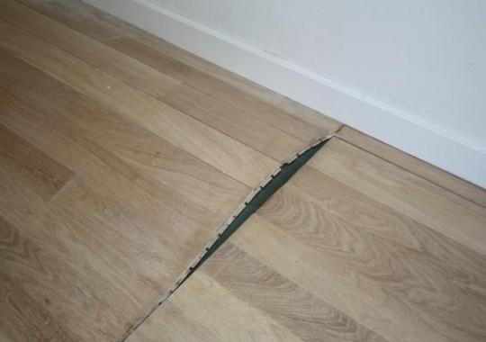Opgebolde-parketvloer-als-gevolg-van-ontbreken-van-vochtscherm