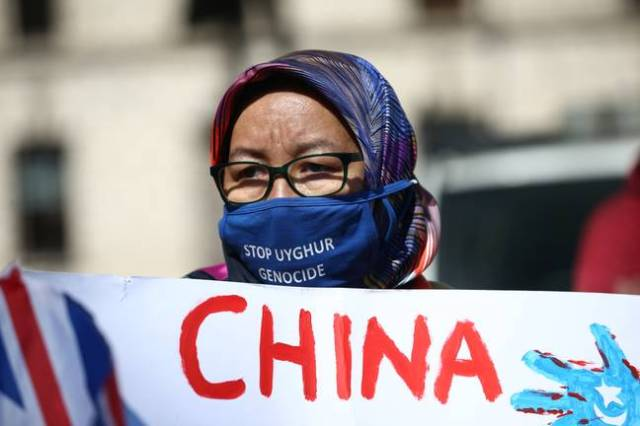 A protest against the treatment of Uighurs in London. (PA Images)