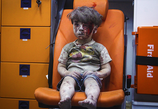 Footage Of Bloodied Boy Who Became Symbol Of Struggle In Syria Shows Him Smiling And Happy At Home omar web