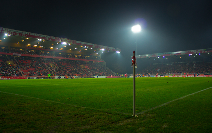 Rectangle of green under floodlights