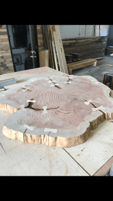 60 Inch Round Redwood Top with Maple Bowties