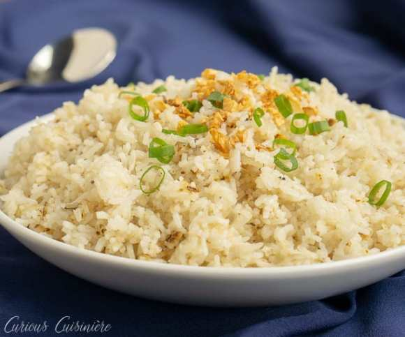 Filipino Garlic Fried Rice oozed with bits of scallion on top.