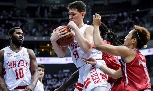 A Filipino basketball player's love for basketball is seen as he struggles to get past his defenders in an NCAA game