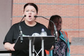Photograph of Paula Barker (Regional Convenor, UNISON North West) addressing NO MORE AUSTERITY demonstrators at Castle Arena, Manchester.