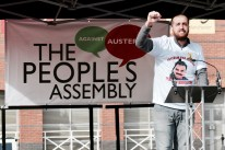 Photograph of a representative from the Kurdish People's Assembly addressing NO MORE AUSTERITY demonstrators at Castle Arena, Manchester.