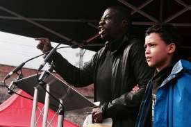 Photograph of Weyman Bennett (Joint National Convenor, Stand Up to Racism) addressing NO MORE AUSTERITY demonstrators at Castle Arena, Manchester.
