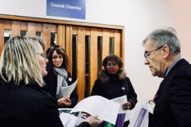 Photograph of UNISON activists and Councillor Martin Terry discuss fair pay motion before the full meeting fo Southend-on-Sea Borough Council on Thursday 14th December.