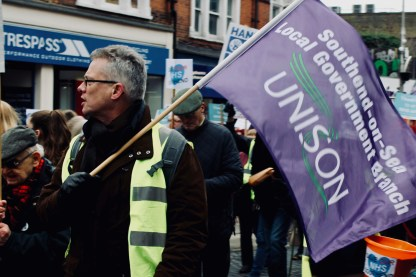 Photograph of Tim Sneller (Communications Officer, UNISON Southend-on-Sea) marching up the High Street, Southend-on-Sea.