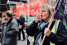 Photograph of Claire Wormald (Secretary, UNISON Southend-on-Sea) addressing Save Our NHS Southend campaigners marching up the High Street, Southend-on-Sea.