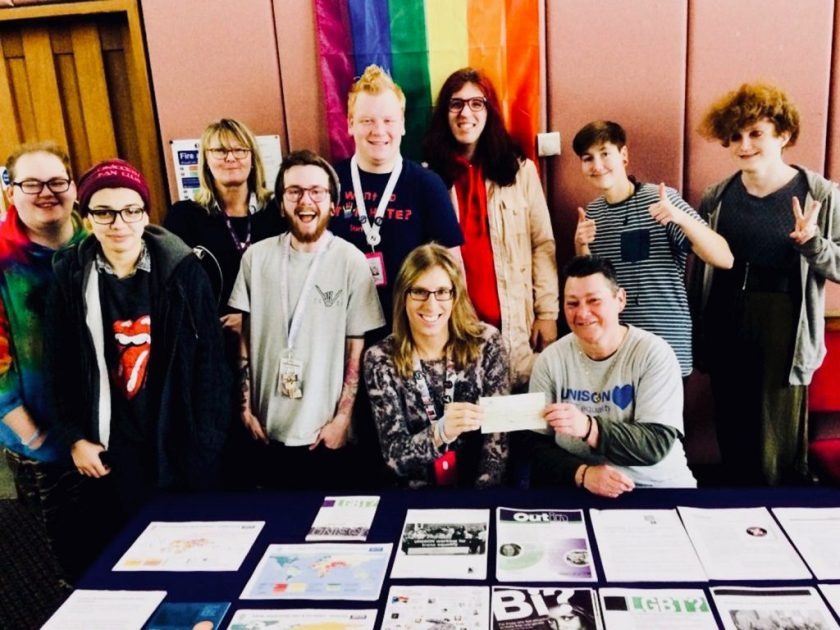 Group photograph featuring Sam Adams (LGBT+ Officer) presenting a cheque for £100 from UNISON Southend-on-Sea branch to help TRANSPIRE continue its work supporting the local community.
