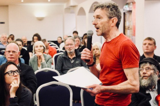 Photograph of attendee addressing participants at The People's Assembly Against Austerity CHANGE IS COMING conference.