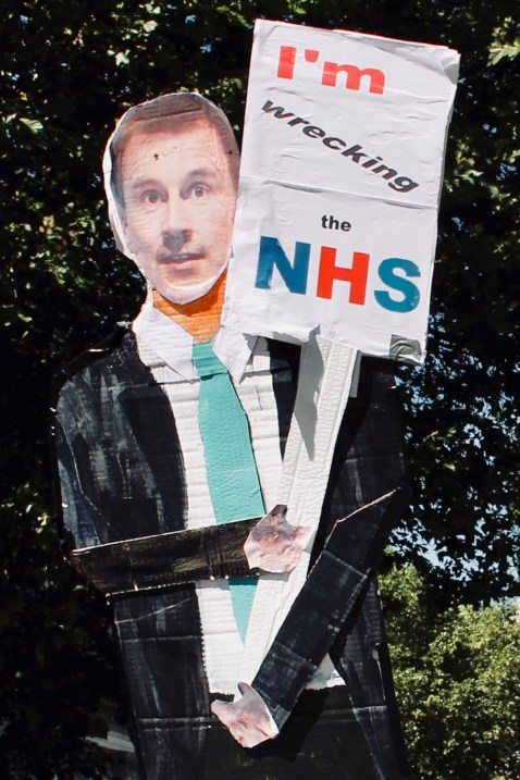 Placard depicting Jeremy Hunt (Secretary of State for Health and Social Care) with the slogan: I'M WRECKING THE NHS