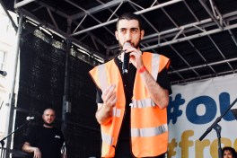 Photograph of spoken word performer at 'Our NHS is 70' rally at Westminster, London. (30 June 2018)