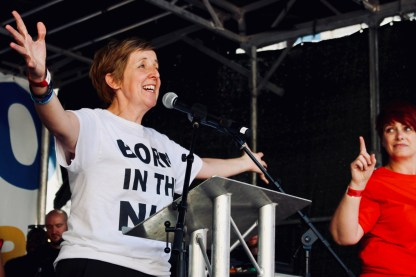 Photograph of Julie Hesmondhalgh (Actress and President, The People's Assembly Against Austerity) addressing 'Our NHS is 70' rally at Westminster, London. (30 June 2018)