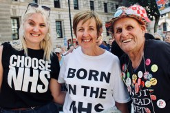 Photograph of Julie Hesmondhalgh (Actress and President, The People's Assembly Against Austerity) with demonstrators at 'Our NHS is 70' rally at Westminster, London. (30 June 2018)