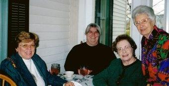 The ladies celebrate Bess Einstandig's 88th birthday on Dec. 8, 2001. From left: Patty Lewis, Jan Chait, Allane Zucker, Bess Einstandig.