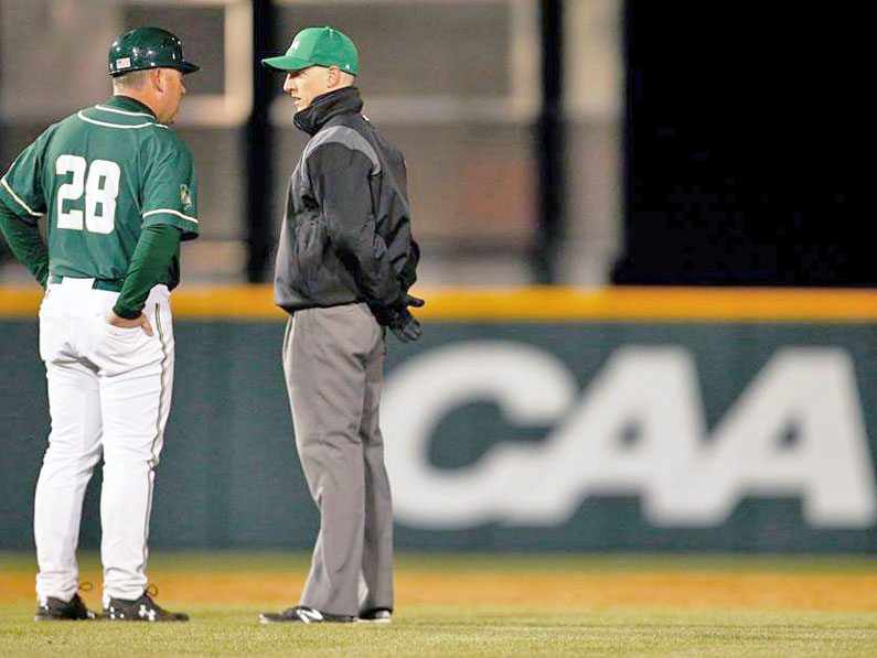 Brian discusses a play with manager in a CAA game
