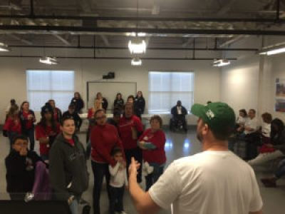 Jeff Winkler, director of United Way's RealSense, rallies volunteers prior to neighborhood canvassing to educate residents about financial resources.