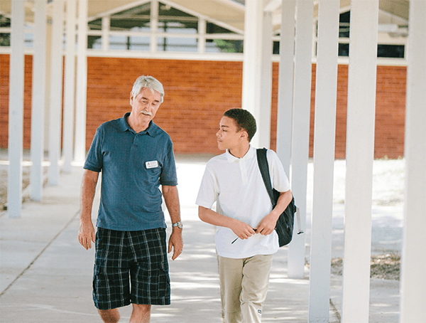 Mickey McCown is using his decades of teaching experience to mentor students like Tierney, supporting them in their educational goals and providing emotional support to reach their dreams.