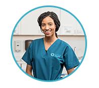 Unitek nursing student standing in a doctor's office