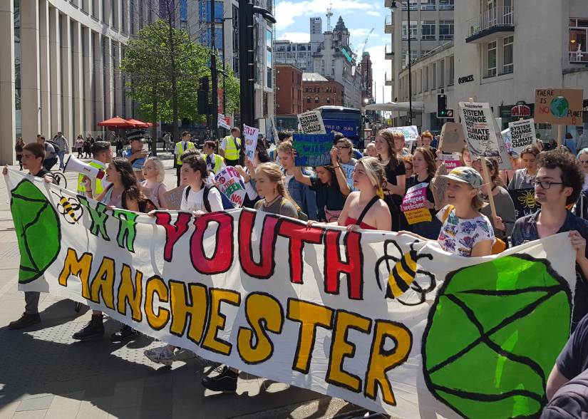 Crowd of young people with banners and placards