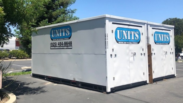 corporate portable storage in a parking lot outside of office