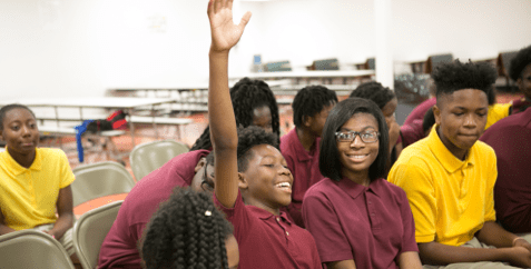 student raising hand