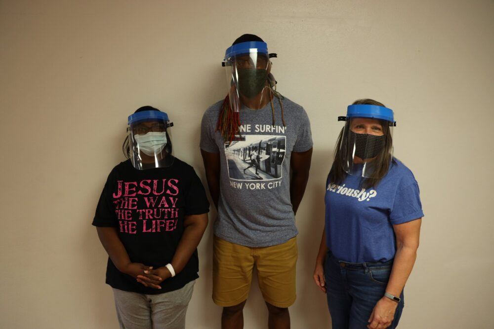 Three Unity people wearing face shields