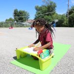 girl-lapdesk-parking-lot-2020-09