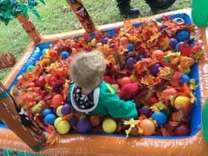 back of girl in ball pit
