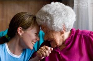Senior holding hands with Caregiver.
