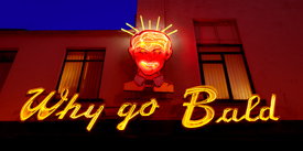 Universal Clinic's famous 'Why Go Bald' Neon Sign