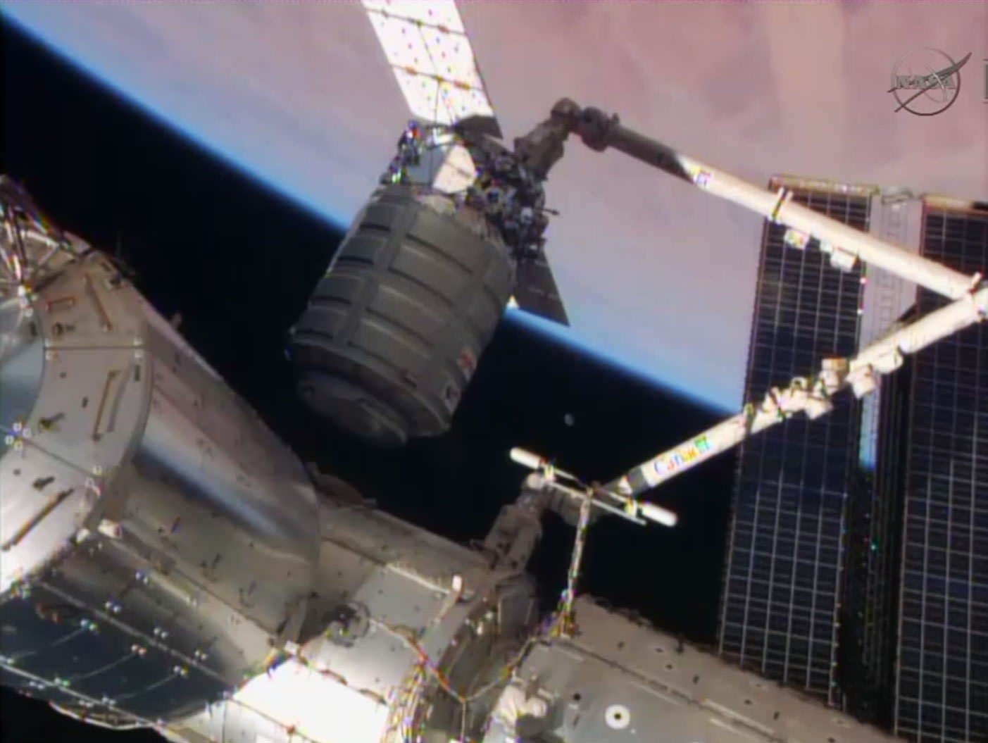 Private Cygnus Freighter Berths at Space Station with Huge ...