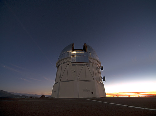 The silvered dome of the Blanco 4-meter telescope holds the DECam at the Cerro Tololo Inter-American Observatory in Chile. (Photo credit: T. Abbott and NOAO/AURA/NSF)