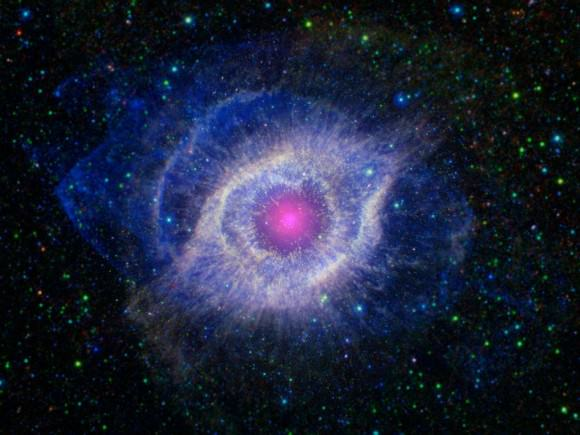 Image of the Helix Nebula, combining from information from NASA's Spitzer Space Telescope and the Galaxy Evolution Explorer (GALEX). Credit: NASA