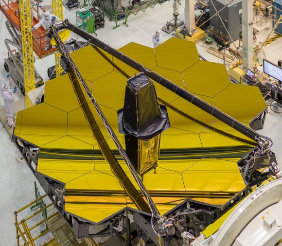 The primary mirror of the James Webb Space Telescope is unfolded once it's in space. If it fails to deploy properly, NASA may need to use the Dream Chaser to keep the Hubble Telescope operating instead. Image: NASA/Chris Gunn
