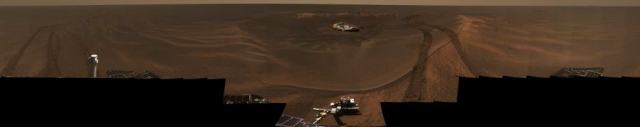 """This panorama image, called """"Lion King"""" was assembled from 558 images totalling over 75 megabytes. The rock outcrop, the landing pad, and the rover's tracks are all clearly visible. Image: NASA/JPL/Cornell"""