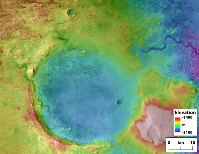 The Perseverance rover is on the ground in the Jezero crater. The outlet canyon carved by overflow flooding is visible on the upper right side of the crater. Ancient rivers carved the inlets on the left side of the crater. Credit: NASA/Tim Goudge.