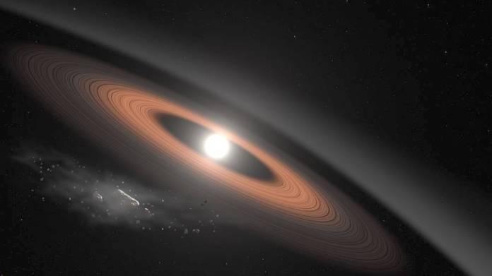 Eine Abbildung des weißen Zwergsterns LSPM J0207 + 3331, etwa 145 Lichtjahre entfernt. Es ist von einem Staubring umgeben, in dem Lücken darauf schließen können, dass sich Planeten bilden. Im Vordergrund sind zerbröckelnde Asteroiden, die etwas von dem Staub liefern. Bild-Gutschrift: Goddard Space Flight Center der NASA / Scott Wiessinger