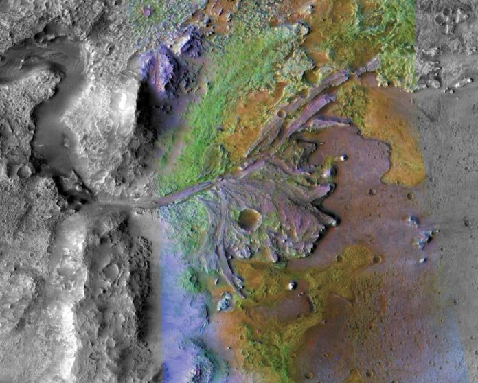 This image of Jezero Crater on Mars comes from the CRISM instrument on the MRO. CRISM is an imaging spectrometer built to detect clays on Mars. In this image, the clays appear green. Image Credit: NASA/JPL-Caltech/ASU
