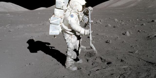 Image of Apollo Astronaut Harrison Schmitt diggin in the lunar dust that he is actually allergic to.