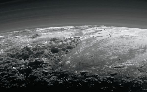 After its closest approach to Pluto, New Horizons looked back toward the planet and captured this near-sunset view of its rugged, icy mountains and flat ice plains. The smooth expanse of Sputnik Planitia (right) is flanked to the west (left) by rugged mountains up to 11,000 feet (3,500 m) high. Some want to send another mission to Pluto, this time an orbiter. Image Credit: NASA/JHUAPL/SwRI