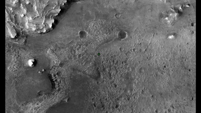 This image shows with a green dot where NASA's Perseverance rover landed in Jezero Crater on Mars on Feb. 18, 2021. The base image was taken by the HiRISE camera aboard NASA's Mars Reconnaissance Orbiter (MRO). Along with the Mars Express Orbiter, the MRO has imaged Jezero in detail. Image Credit: NASA/JPL-Caltech/University of Arizona
