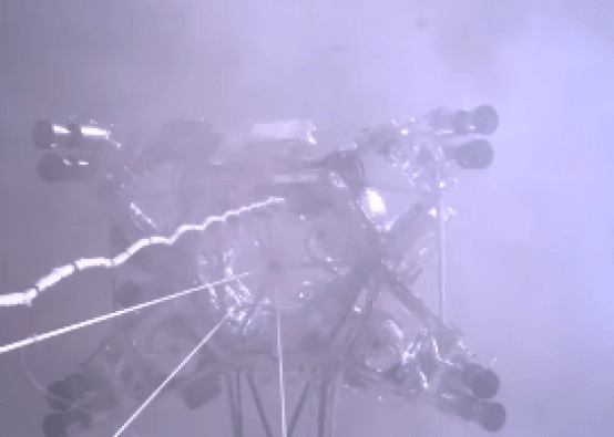 This still image comes from a video taken with a camera on the Skycrane as it lowers Perseverance into the swirling dust kicked up by the landing rockets. Image Credit: NASA/JPL/Caltech