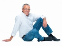 http://www.dreamstime.com/royalty-free-stock-photos-mature-man-sitting-white-background-image7456878