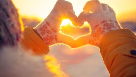 33571956 - woman hands in winter gloves heart symbol shaped lifestyle and feelings concept with sunset light nature on background