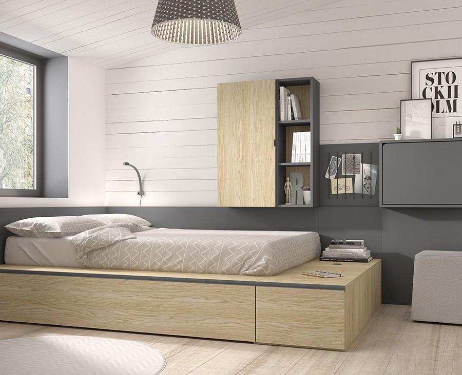 chambre avec lit gigogne avec 1 tiroir 3 coffres des etageres d un bureau rabattable et un panneau avec elastiques