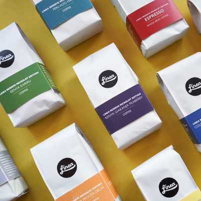 Multiple bags of colorful Linea coffee