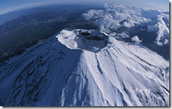 A aerial, wide-angle view of Mt. Fuji's crater