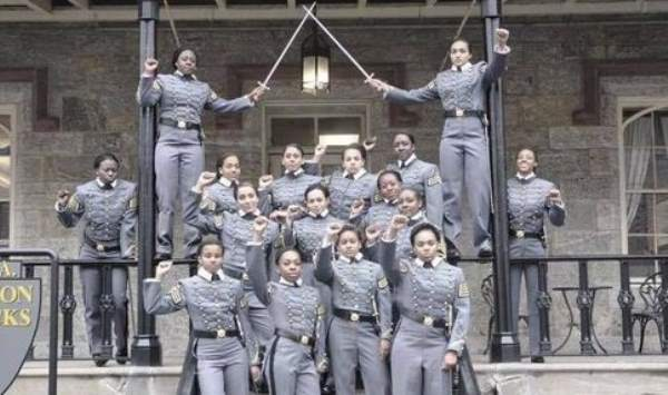A-group-of-female-black-West-Point-cadets-with-their-fists-raised